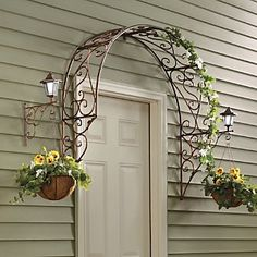 Over-the-Door Arch Trellis from Through the Country Door®. I love this minus the porch lights and the hanging baskets - i'd rather have grapevines or hops climbing this metal arch Outdoor Crafts, Outdoor Projects, Garden Projects, Outdoor Decor, Outdoor Ideas, Craft Projects, Arch Trellis, Trellis Ideas, Wisteria Trellis