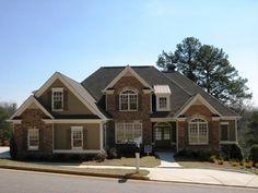 Has 28 pics of finished house plus floorplan: 3,065 sq ft, 4 BD/3.5 Ba, 3 car garage, master on main  houseplans.net/floorplans/28600016