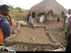 Oh my god, these villagers built a pool table out of mud and sticks. This is the greatest thing....
