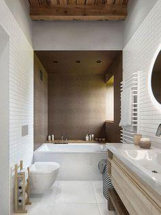 Baño con pequeños azulejos en la zona de la bañera