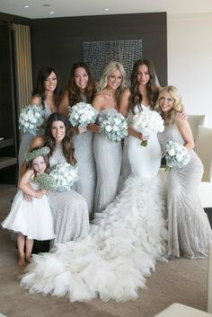 white bouquet for the bride & matching color bouquets for the bridesmaids