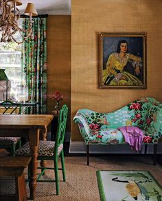 So in love with the chinoiserie fabrics on lounging sofa (fainting couch) and at the window! The painted green chairs and natural wood table look divine too