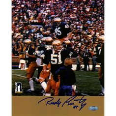 Rudy Ruettiger Signed Carry Off Vertical 8x10 Photo (Signed in Blue) - Rudy Ruettiger personally hand-signed this Carry Off Vertical 8x10 Photo signed in blue. An undersized kid with over-sized dreams Rudy repeatedly was told he was too small to play football. While at Notre Dame Ruettiger was part of the scout team and on the last play of the final game of his senior year Rudy finally was put in. Ruettiger made the most of it recording a tackle and prompting his teammates to carry him off…
