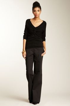 I like the wide leg pants and the slouchy top. It has a nice cut and doesn't show too much cleavage