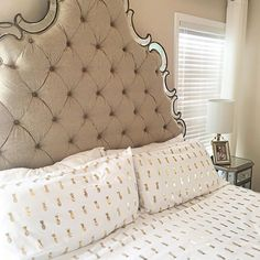 The cutest gold and pineapple sheets. Tuffed headboard. Master bedroom decor. Gold decor. White decor. Mirrored furniture. Target style. Homegoods happy.
