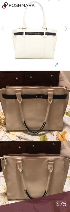 """Cole Haan Cameron large Satchel - Ivory and Black - Dual rolled top handles - Zip top closure - Interior features zip wall pocket and 2 media pockets - Dust bag included - Approx. 8"""" handle drop - 100% genuine leather exterior, 100% polyester interior All zippers are functional.   There is a scratch on the front of the bag that was there when purchased. Please see pictures.  Bag has been used maybe 5 times. Cole Haan Bags Satchels"""