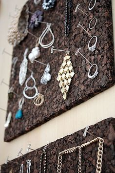 Cork board panels to hold jewelry-- this would be fun with some pretty pins from an office store. :)