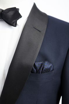 Beautiful dark blue tux with black satin trim and a black bow tie - the perfect holiday party look.