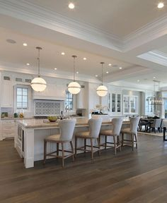 The countertop is Taj Mahal Quartzite and the linen counterstools are from Restoration Hardware.