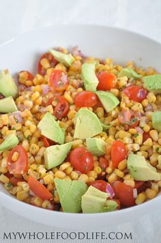 Corn, Tomato and Avocado Salad is the perfect summer side dish!  Only a handful of simple ingredients!  #vegan #glutenfree #salads