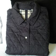 BURBERRY OUTER JACKET Black Burberry Quilted Jacket with Nova Check lining , pointed collar, dual patch pockets and front snap closures, Burberry Jackets & Coats