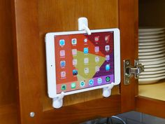 Protect your tablet from splashes and read recipes at eye level. All for just a few dollars.