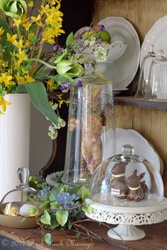 Love the idea of decorating with chocolate bunnies on a cake plate with a cloche top....