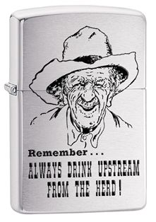 """Partner up with this brushed chrome cowboy lighter. This windproof lighter displays an image of a cowboy with the phrase """"remember…always drink upstream from the herd!"""" making this a comical piece. Comes packaged in an environmentally friendly gift box. For optimal performance, use with Zippo premium lighter fluid."""