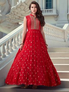 Graceful red embroidered gown online at best shopping price. Shop this latest gown style for diwali celebration. This alluring style set comprises a georgette gown with matching net dupatta.