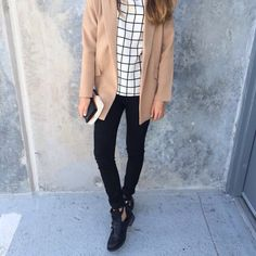 Brown coat, black and white square design shirt and black ankle boots