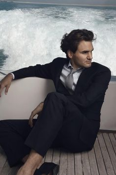 two good things in this picture....Roger Federer ....& his suit!!! <3