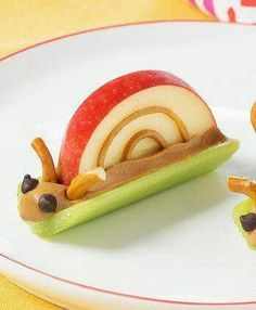 A Kawaii food childrens cute healthy snale snack with peanut butter celery apple pretzels and mini chocolate chips. I love it!