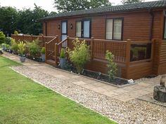 Fensys lodge decking finished with golden oak balustrade hand rail