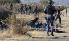 Bloodbath In South Africa Miners killed during clashes between protesting mine workers and police forces near a platinum mine in Marikana on August 16, 2012. (AFP/GettyImages)