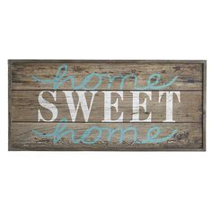 Whether grand or humble, this rustic sign reminds us there's no place like home sweet home. Now, if we just had some ruby slippers.