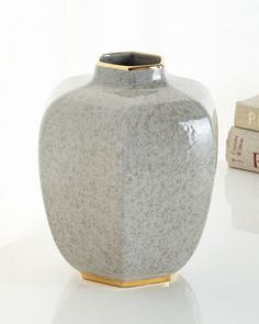 "Handcrafted vase. Glazed ceramic with 18-kt. gold accents. 8""Dia. x 9""T. Made in Italy."