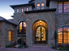 Beautiful stonework on this Mediterranean home.