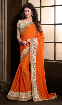 Look ethereal wearing this orange color embroidered chiffon sari. The ethnic resham and lace work in the attire adds a sign of attractiveness statement for your look. Indian Designer Sarees, Latest Designer Sarees, Latest Sarees, Designer Sarees Collection, Saree Collection, Party Wear Sarees Online, Party Sarees, Sari Design, Sarees Online India