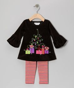 This sweet little set is what every girl dreams of, and then some. The playful gift-wrapped boxes on the luxurious velour top set the stage for a great day, while the candy-stripe leggings tie the whole special ensemble together.