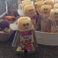 Preschool snack, raisins, juice box, pretzel stick and applesauce