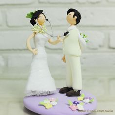 AH AH AH! LOVE THIS! She has a stethoscope & is listening to his heart. Love this cake topper!