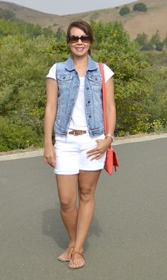Love the denim vest over white tee with white shorts. A pop of coral in the handbag is the perfect finishing touch.