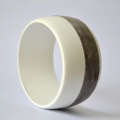 Concrete on wooden bangle  white and dark grey by cementology, €21.00