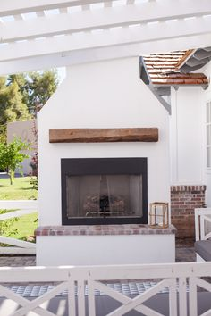 Outdoor fireplace - by Rafterhouse.