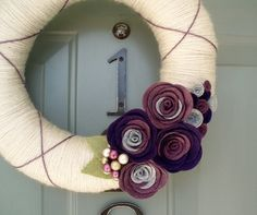 Yarn Wreath & Felt Flowers. LOVE. Made one for my front door- makes me smile every day. :)