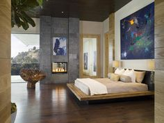 William Laga art, an organic root chair, a reclaimed wood bed, warrior bedside lamps and a fig leaf ficus are all the decoration this majestic bedroom needs.