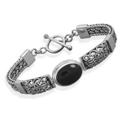 "Oval Black Onyx Filigree Sterling Silver Toggle Bracelet -  Handcrafted sterling silver Bali filigree toggle bracelet with oval black onyx cabachon.  Bracelet measures 7-1/2"" long; black onyx gemstone is 15mm long and 12mm wide."