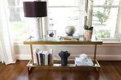 Sarah Harmeyer made sure to include plenty of glitzy elements, including the glass and gold console table.