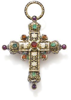A gemset and enamel cross pendant set with emerlds and garnets, with champleve enamel .