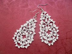 Handmade tatted silver and white earrings made of polyester thread  and beads…