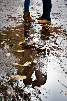 Raining when you are taking your engagement photographs? Take a tip from this fall photoshoot and use the rain puddles to your advantage.