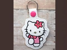 Cute Kitty Key Fob  This adorable Kitty design sews in the 4x4 hoop.  Available Formats Include - PES, PEC, HUS, JEF, VIP, VP3, and EXP  You may make this design as many times as you like, and you may sell your finished key fobs, however, please do not modify, share or resell my original digital design.  Thanks so much and happy stitching!!