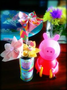 Peppa pig origami paper flowers. ..I just did it for my little one who loves peppa so much.