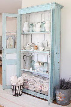 Aqua painted rustic wood cabinet with doors for a lot of storage space