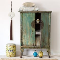 A beautiful Chinese pine cabinet c.1920 Shandong Province, with a handsome turquoise and cream distressed finish  http://www.orchidfurniture.co.uk/turquise-and-white-distressed-cabinet-shandong-province-c-1920