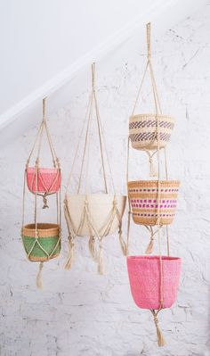 These beautiful, single tier plant hangers are hand woven from jute plant. This versatile shrub grows abundantly in Bangladesh, where the hangers are ethically made by women working within a large network of village cooperatives. These aesthetic and sturdy hangers work exceptionally well with our woven baskets. Size: 1 TIER - 120CM Also available in two tier length. Please Note: Baskets are not included--Padma 1 Tier Macrame Plant Hanger These beautiful, single tier plant hangers are hand… Basket Weaving, Hand Weaving, Woven Baskets, Colourful Living Room, Jute Twine, Colorful Decor, House Colors, Boho Decor, Plant Hangers