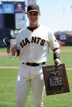 Buster with the Jackie Robinson Award