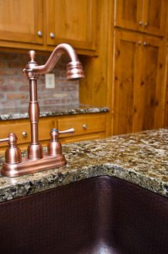 copper faucet and copper sink, but a dark patina.