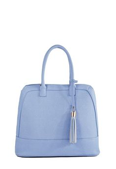 Sweet and chic for feminine carry. Clean front with subtle stitching. Modern design with festive front hanging tassel for unexpected detail. ...