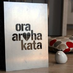 Maori Live, Love, Laugh in industrial recycled steel.
